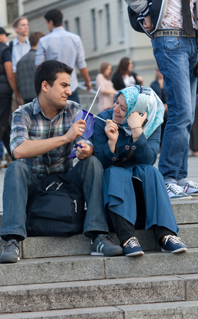 eastern european ethnicity: UKRAINE, KIEV - September 11,2013: Arab students are resting at the Independence Square