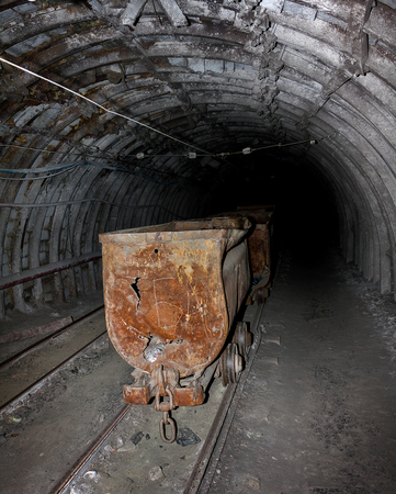 Empty mine trolley in mines Stock Photo