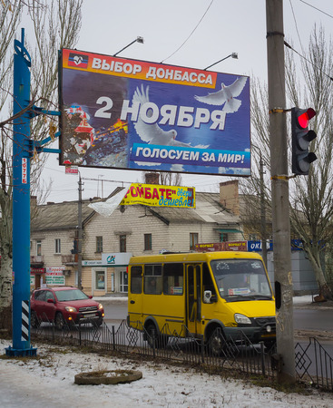 separatism: Makeevka, Ukraine - January, 23, 2015: Billboard, remaining after the elections with a call for peace