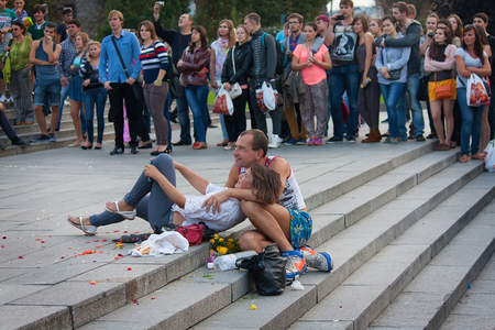 submission: UKRAINE, KIEV - September 11,2013: Homeless couple watching a concert during mass submission to the Independence Square