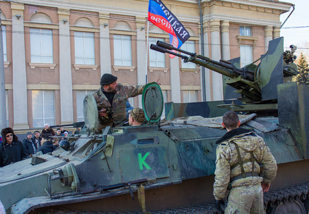 Makeevka, Ukraine - February, 22, 2015: Soldiers of the Peoples Republic of Donetsk in the central square Editorial
