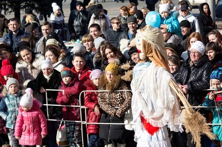 Makeevka, Ukraine - February, 22, 2015: Residents of the city at the holiday of Shrovetide during the civil war in Ukraine