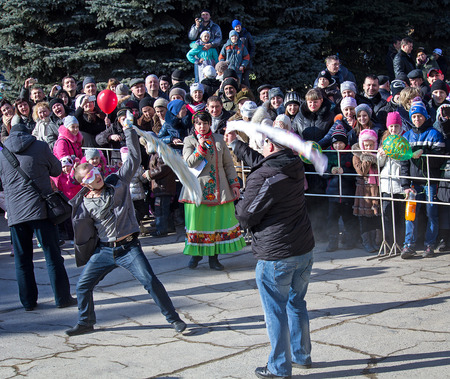 Makeevka, Ukraine - February, 22, 2015: Comic fight during festivals in honor of the arrival of spring Editorial