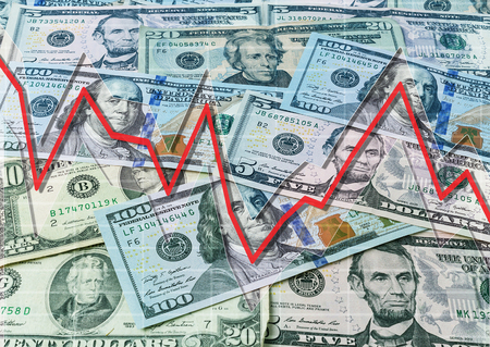 indices: Dollars and descending graph Stock Photo
