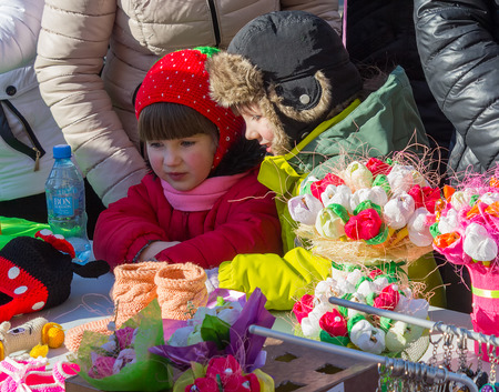 Makeevka, Ukraine - February, 22, 2015: Children on holiday of Shrovetide in Donetsk Peoples Republic