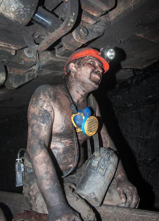Novogrodovka, Ukraine - January, 18, 2013: Miner in the workplace in the mine 13 Novogrodovskaya at a depth of 800 meters below ground