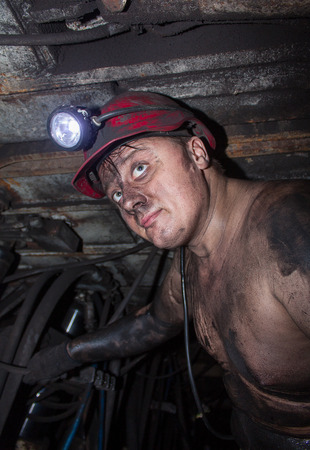 anthracite coal: Miner in the workplace in the mine at a depth of 800 meters below ground