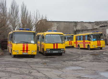 retrieval: Donetsk, Ukraine - April, 11, 2014: Buses rescuers at the mine named after Skochinskiy during work to rescue the miners blocked and retrieval of those killed in the accident Editorial