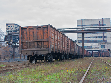 shearer: Train under loading of coal at a coal mine Stock Photo