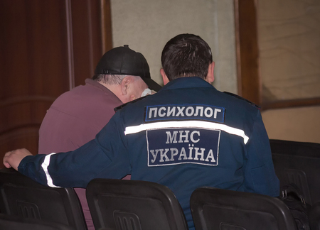 psychologists: Donetsk, Ukraine - April, 11, 2014: Psychologists Ministry of Emergency Situations are working with the relatives of the dead miners in an accident at the mine named Skochinskiy