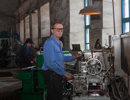 Ukraine, Anthracite - May 15, 2013: Turner in the workplace. Antratsitovsky repair and engineering works. Lugansk region