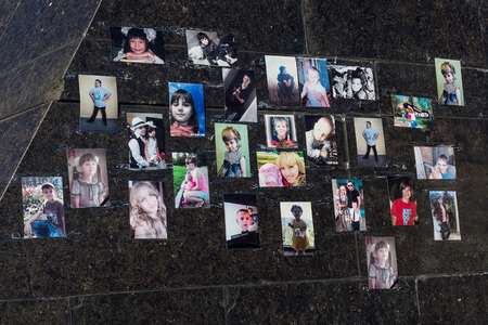 separatism: Donetsk, Ukraine - March, 25, 2015: Photos of the victims of the civil war children Donbass in the central square