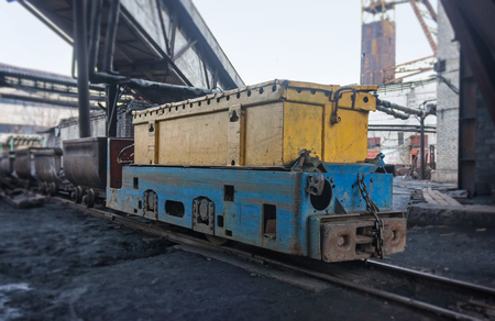 shearer: Train in national colors with trolleys in a coal mine. Donbass, Ukraine