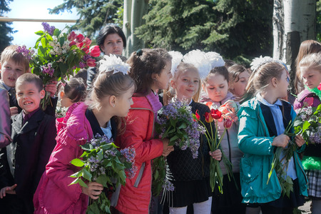Makeevka, Ukraine - May, 7, 2014: Children congratulate veterans of World War II on the anniversary of the victory over fascism