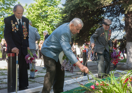 Makeevka, Ukraine - May, 7, 2014: World War II veterans laid flowers at the monument to fallen comrades Editorial