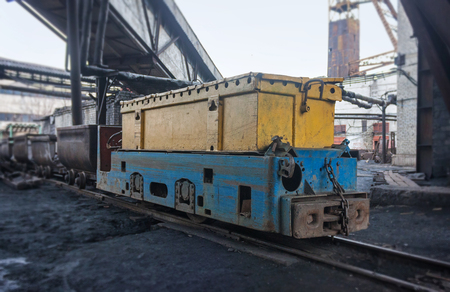 anthracite coal: Train in national colors with trolleys in a coal mine. Donbass, Ukraine