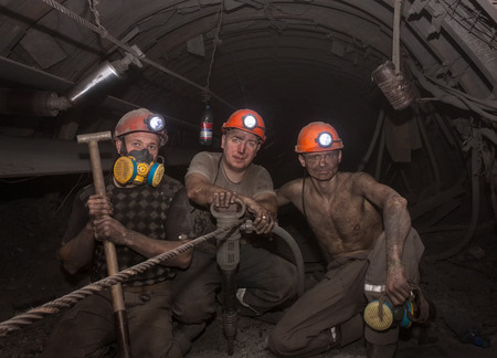Donetsk, Ukraine - March, 14, 2014: The miners working underground in the mine named Abakumov in dusty conditions