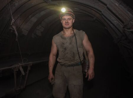 anthracite coal: Donetsk, Ukraine - March, 14, 2014: Miner in an underground tunnel in the mine named after Abakumov