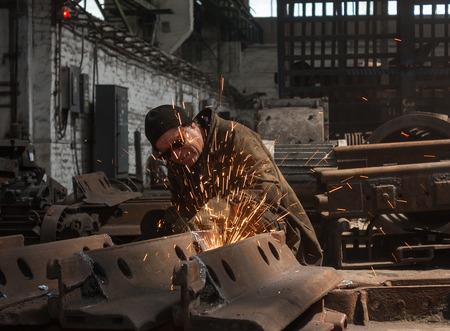 fabricator: Thorez, Ukraine - July, 22, 2013: Welder at work. Repair and Engineering Works