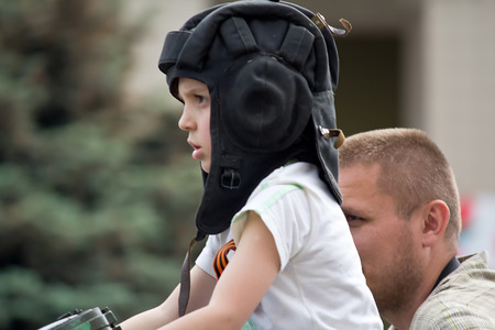 Makeevka, Ukraine - May, 9, 2012: A boy wearing a helmet at the parade in honor of the anniversary of the victory over fascism