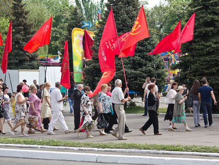 proponents: Makeevka, Ukraine - May, 9, 2012: Proponents of communist ideology in a parade to celebrate the anniversary of the victory over fascism Editorial