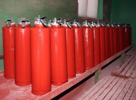 extinguishers: Plant for the production of fire extinguishers. After painting Stock Photo