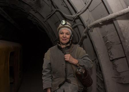 anthracite coal: Donetsk, Ukraine - March, 14, 2014: Woman surveyor in the underground mine. Mine is named Abakumov