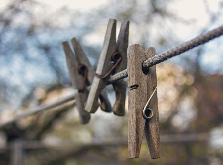 clothesline: Old clothespins on clothesline close-up Stock Photo