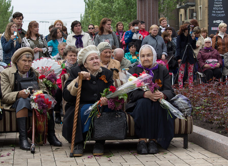 witnesses: Donetsk - May 9, 2015: Women - witnesses of World War II at a concert in honor of the victory in World War II