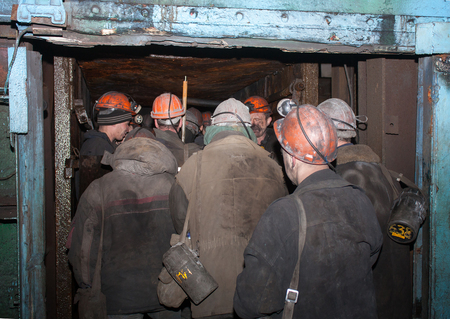 Gorlovka, Ukraine - February, 26, 2014: Miners of the mine named after Kalinin down in underground mines Stok Fotoğraf - 40485319