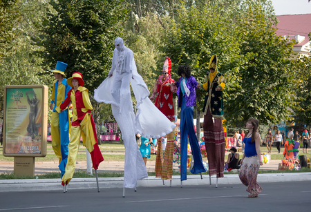Makeevka, Ukraine - August, 25, 2012: People in costume and on stilts at the celebration of the founding of the city Editorial