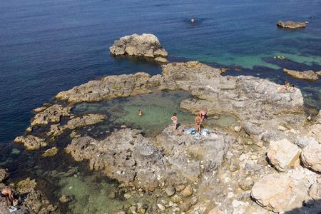 vacationers: Vacationers sunbathing on the rocky coast of Sevastopol