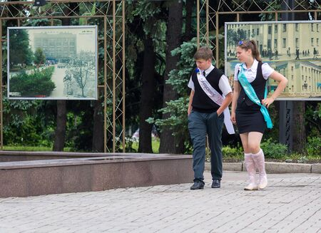 Makeevka, Ukraine - May 29, 2015: Graduates near the fountain. The first issue after the beginning of the military conflict in the territory controlled by the Peoples Republic of Donetsk.