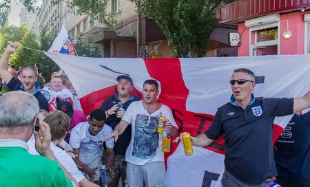 european championship: Donetsk, Ukraine - June, 11, 2012: British sports fans sing hymns before the match at the European Championship