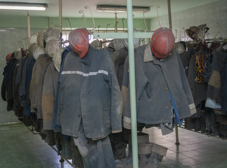 closet rod: Overalls miners working in the locker room