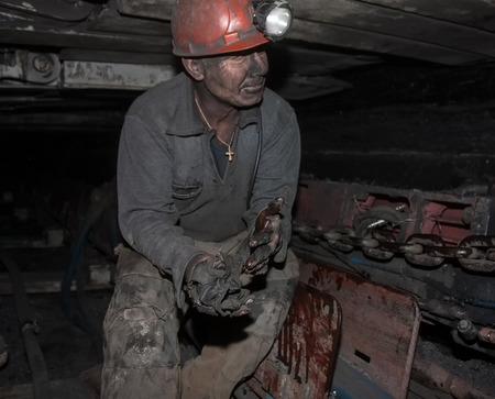 industry power: Donetsk, Ukraine - August, 16, 2013: Miner repairs coal mining combine. Mine name Chelyuskintsev