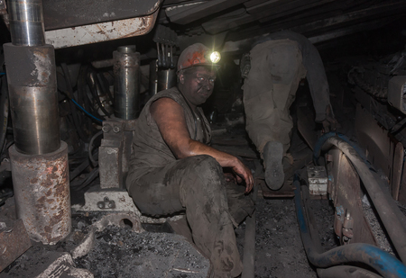 cramped: Donetsk, Ukraine - August, 16, 2013: Miners at work in cramped conditions underground excavation. Mine name Chelyuskintsev