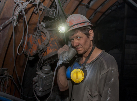 anthracite coal: Donetsk, Ukraine - March, 14, 2014: Miner with a phone in the mine named after Abakumov