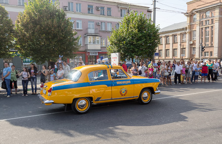patrol car: Makeevka, Ukraine - August, 25, 2012: Retro cars - patrol car since the Soviet Union at the parade during the celebration of the city day Editorial