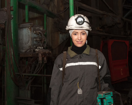 donbass: Dzerzhinsk, Ukraine - March 03, 2014: Young woman - surveyor before the descent into the underground workings. Mine is named Saint Matrona of Moscow