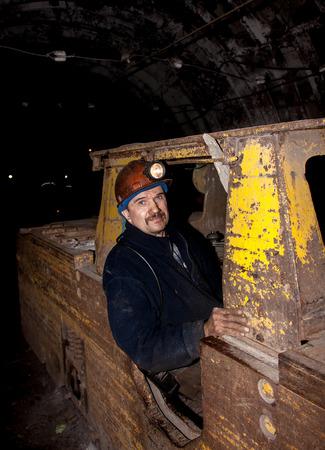 anthracite coal: Novogrodovka, Ukraine - January 18, 2013: Driver of the underground electric workplace. Mine 13 Novogrodovskaya at a depth of 800 meters below ground
