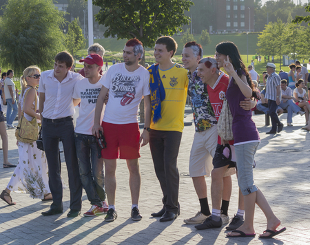 football european championship: Donetsk, Ukraine - June 11, 2012: Fans from different countries together are photographed before the match at the European Championship in football Editorial