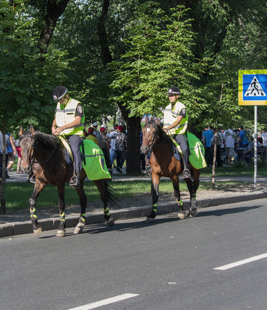 constabulary: Donetsk, Ukraine - June 11, 2012: Police on horseback patrolling the streets during the European Football Championship