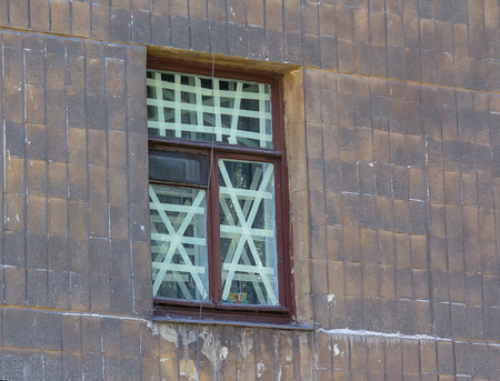 shelling: Orthodox icon on the window crosses in the area to be shelling. Ukraine
