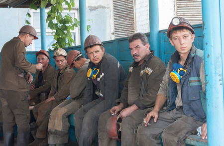 miners: Ugledar; Ukraine - July 17; 2013: Miners Coal Mine South Donbass №1 smoke before going into underground workings