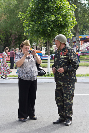 wojenne: Makeevka, Ukraine - May, 9, 2012: Participants of the historical parade in honor of the victory in World War II