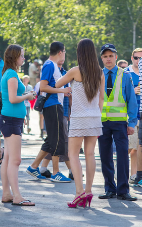 Donetsk, Ukraine - June 11, 2012: Young officer was talking to a woman during the European Championship in football Editorial