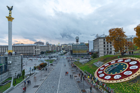 maidan: Kiev, Ukraine - October 24, 2015: Panoramic view of the evening Independence Square and the street Institutskaya