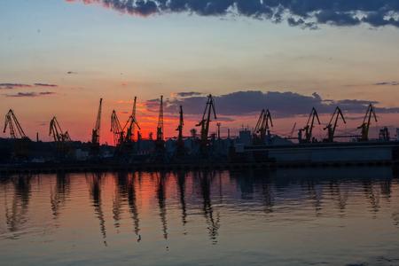 odessa: Silhouette of sea port at dusk. Odessa, Ukraine
