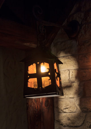 scintillating: Wooden stylized ancient lantern. Interior and lighting